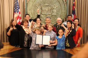 Governor Ige and kids at cool-schools bill signing