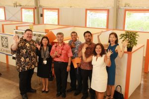 Gov. Ige, DHS director Pankaj Bhanot and state homelessness coordinator Scott Morishige with staff at the new Family Assessment Center in Kaka'ako.