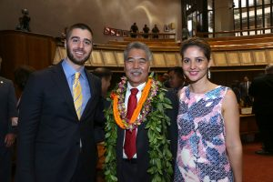 Governor Ige with Shaka Tea owners Harrison Rice and Bella Hughes in the House chamber.