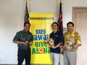 (L-R): DBEDT Director Luis Salaveria, Jimmy Chan, president of Hawaiian Chip Company, Dennis Ling, administrator DBEDT's Business Development and Support Division