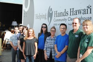 HELPING HANDS: A team of service providers lends support to homeless client Jodi Jennette Inks (fourth from left). From left to right: Jay Parasco, homeless coordinator, City and County of Honolulu; Scott Morishige, state homelessness coordinator; Gladys Peraro, U.S. Vets Waianae; Jodi Jennette Inks, client; Meg Gavigan, team leader for Hawaii Pathways Project (Helping Hands Hawaii and Catholic Charities Hawaii partnership); Heather Pierucki, director of behavioral health for Helping Hands Hawaii; Ching Ying Jao, case manager for Hawaii Pathways Project and Helping Hands Hawaii; Bill Hanrahan, Mental Health Kokua; Leslie Uyehara, Kalihi Palama Health Center