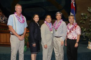 Team of the Year: DCCA director Catherine Awakuni, manager Jeffrey Ono, and Dean Nishina with Gov. Ige.