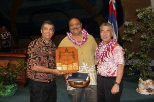 Top manager: Mark Patterson with DHS director Pankaj Bhanot and Gov. Ige.
