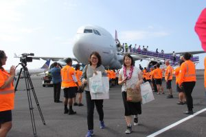 TOURISM AND BEYOND: Japanese visitors arrive at Kona International Airport.
