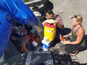 REACHING OUT: Homelessness coordinator Scott Morishige works with Nicole Bieneman of the CHOW project near Chinatown to help homeless individuals.