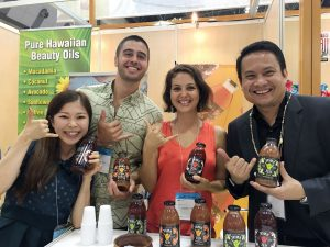 TOKYO SHOWCASE: Shaka Tea owners Harrison Rice and Bella Hat the Tokyo Gift Show with DBEDT director Luis Salaveria and their translator.