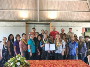 On Molokai, Governor Ige stands with homesteaders and Department of Hawaiian Home Lands officials for the historic bill signing to keep DHHL families statewide on their land.