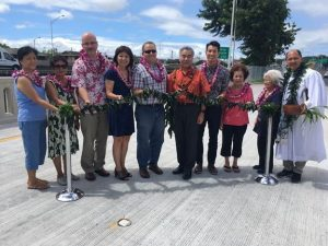 Gov. David Ige, area residents and legislators, representatives from the Federal Highways project team, and Kahu Kordell Kekoa gather to bless the new Halona Street Bridge. From Left to Right: Nida Laganse; Nieves Joaquin; Ralph Rizzo, Federal Highway Administration (FHWA) Hawaii Division Administrator; Sen. Donna Mercado Kim; Dusty Escamilla, FHWA Regional Engineer; Gov. David Ige; Rep. Takushi Ohno; Jane Higa; Florence Higa; Kahu Kordell Kekoa