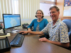 PUTTING HDOT ON THE MAP: Gina Belleau and Ron Dedrick work on details to help the public understand decisions for road repair.