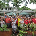 Gov. Ige and Blanche Pope Elementary students helping in the Washington Place garden