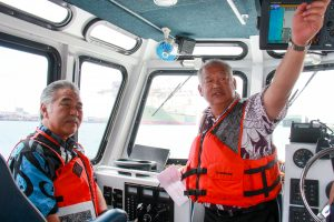 HDOT deputy director Darrell Young and the governor tour Honolulu Harbor.