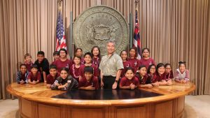 FACES OF THE FUTURE: Gov. Ige with Pearl City Highlands robotics team members, who have competed nationally.
