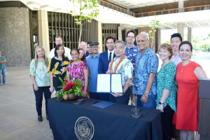 Gov. Ige and legislators make Hawai'i the first state in the nation to enact legislation that abides by the Paris Climate Accord.