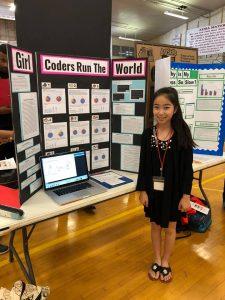7th grader Mira Tsunoda from Kaimuki Middle School with her science project.