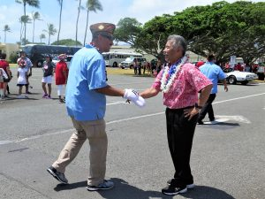 Governor Ige shaking hands