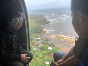 The governor surveys flood damage in Hanalei by helicopter. Gov. Ige made available millions in state funds and is taking steps to secure federal disaster relief.
