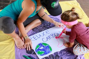 A mom and her daughter send their own message about the Earth reducing its carbon footprint.
