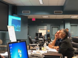 Mayor Carvalho and Governor Ige at a video teleconference on storm damage.