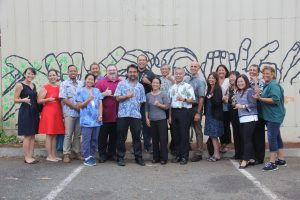 Governor Ige celebrates with the homelessness leadership team and service providers at the Kaka'ako Family Assessment Center's first anniversary.