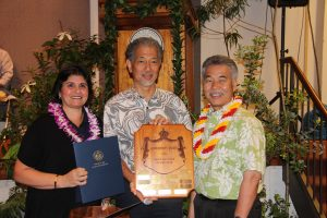 State Manager of the Year JoAnn Vidinhar and Director Leonard Hoshijo of DLIR with the governor.