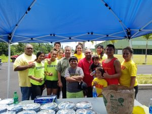 Sergio Mamone (center) and his 'ohana, who helped feed residents displaced by the Kilauea eruption.