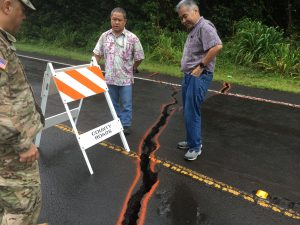 During the Kilauea eruption on Hawai'i island, the governor views cracks on a Puna district road with deputy director of Public Works Merrick Nishimoto.