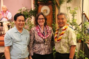 Governor Ige congratulates Attorney General Russell Suzuki and Deirdre Marie-Iha of the state Attorney General's office for their Team of the Year award.