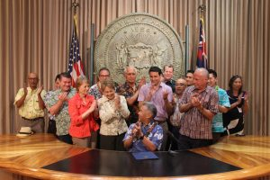 Law banning chlorpyrifos - Legislators join Gov. Ige in applauding the ban on chlorpyrifos.