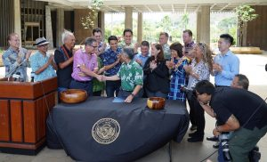 PROTECTING REEFS: Gov. Ige and legislators gather at the Capitol for the historic bill signing.