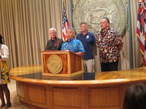 DISASTER AID APPROVED: Gov. Ige, mayors Kirk Caldwell and Bernard Carvalho and FEMA's Dolf Diemont deliver the good news for O'ahu and Kaua'i families.