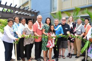 AFFORDABLE RENTALS: Gov. Ige, Ahe Group CEO Makani Maeva and her daughter join officials and residents at a recent Waipahu Tower blessing.