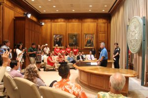 HPD Chief Susan Ballard and advocates join Gov. Ige and legislators for the signing of the bill banning bump stocks and other multi-burst devices.