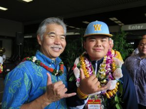 Sean Yamaguchi ready to give the governor his autograph