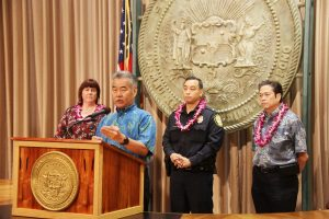 Heather Lusk, HHHRC executive director, and HPD officers join Gov. Ige to announce the new LEAD initiative offering help rather than jail for the homeless.