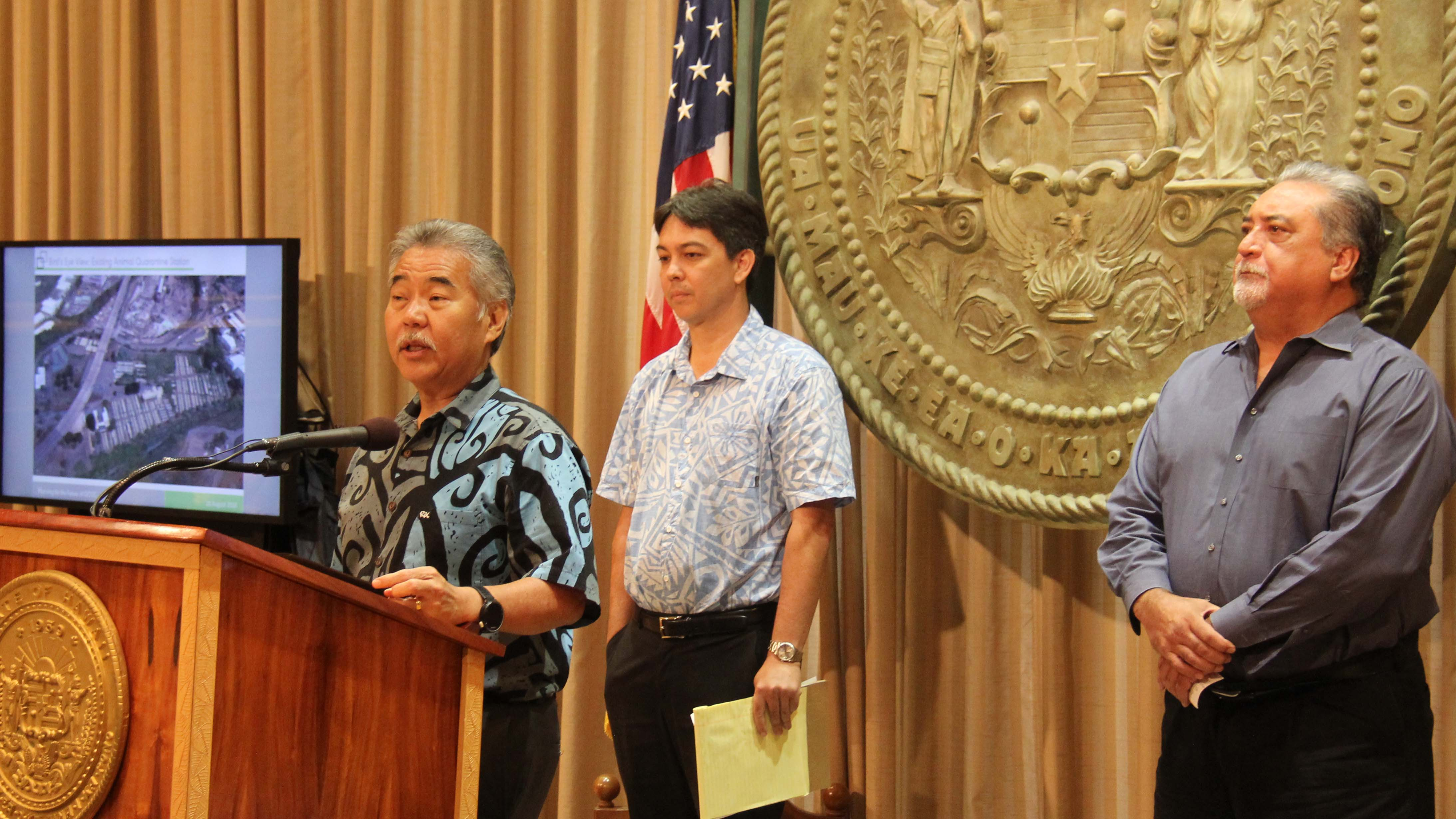 Gov. Ige describes the need to replace OCCC at a press conference with Rod Becker (left), director of the Department of Accounting and General Services and Nolan Espinda, director of the Department of Public Safety.