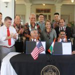 Gov. Ige and Gurudas Pilarnekar, Goa's art and culture director, make history by signing sister-state agreement.