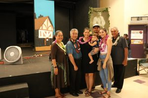 Department of Hawaiian Home Lands director Jobie Masagatani and deputy William Aila with the governor and the Kalena-Dela Cruz family at the lot selection in Kapolei.