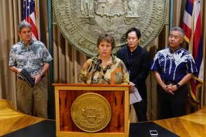 DLNR chair Suzanne Case with Gov. Ige, UH President David Lassner and Attorney General Russell Suzuki.