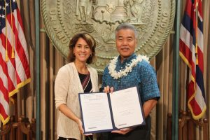 Gov. Ige and DOE Superintendent Christina Kishimoto at the signing of Act 51 to increase computer science education and teacher training in the schools.