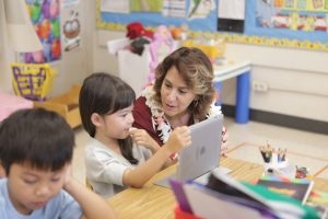 The superintendent sees the technology skills of a Maunawili Elementary kindergartener.