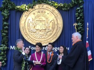 As his family looks on, Governor Ige is sworn in by Chief Justice Mark Recktenwald.