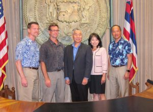 Gov. Ige announces new GEM$ initiative with Murray Clay, Ulupono managing partner; Jay Griffin, Public Utilities Commission chair; Gwen Yamamoto-Lau, director of Hawaii Green Infrastructure Authority; and Scott Seu, VP at HECO.