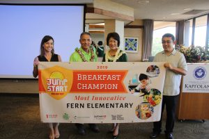 "Fern Elementary principal Glen Miyasato (center) accepts the award for ""Most Innovative"" breakfast program from Mrs. Ige, Daniela Kittinger of Hawai'i Appleseed and Dexter Kishida of the DOE."
