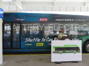 Governor Ige announces a pilot program to select alternative energy buses for the new Conrac facility at the Daniel K. Inouye International Airport in 2021.