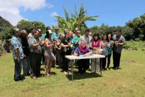 Governor Ige signs HB 329 with community leaders.