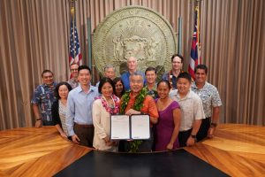 Governor Ige with legislators and affordable housing partners at bill signing.