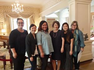 UH West O'ahu's creative media team, with Mrs. Ige and Cynthia Engle (far left), has added 'augmented reality' to Washington Place.