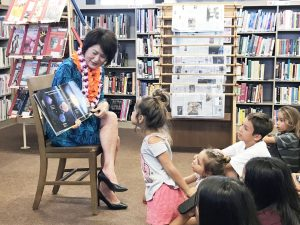 Mrs. Ige reads to young children at the Moloka'i Public Library
