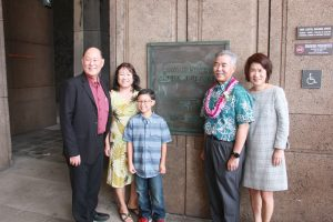 The Taniguchis with grandson Roycen and the Iges by the State Capitol plaque.