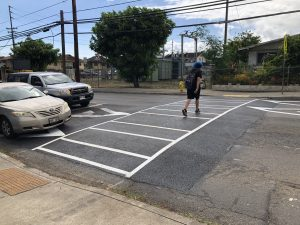 A pedestrian uses one of the five raised crosswalks on Kalihi Street installed in May 2019.